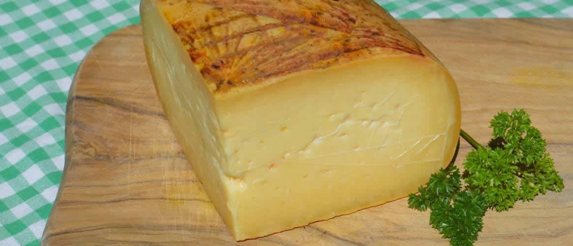 Queso Mahón, cheese made from raw cow and sheep\\'s milk, semi-ripened