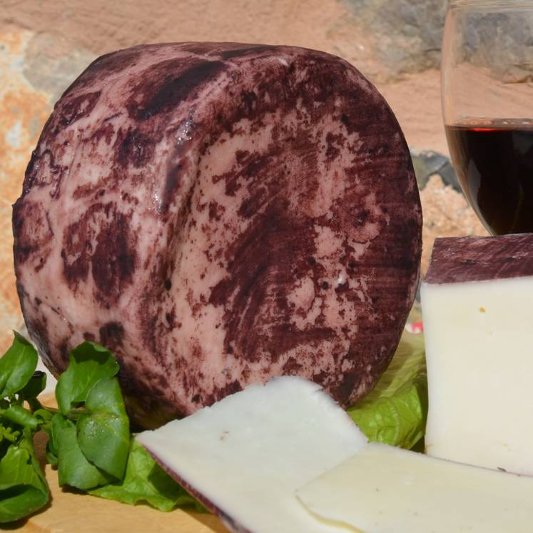 Goat cheese semi matured in red wine coating